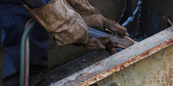 KATZ Metals employee cutting a metal beam in La Crosse, Wisconsin