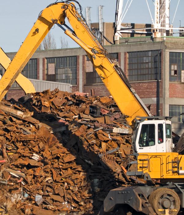 KATZ Metals excavator moving recycled metal in La Crosse, Wisconsin